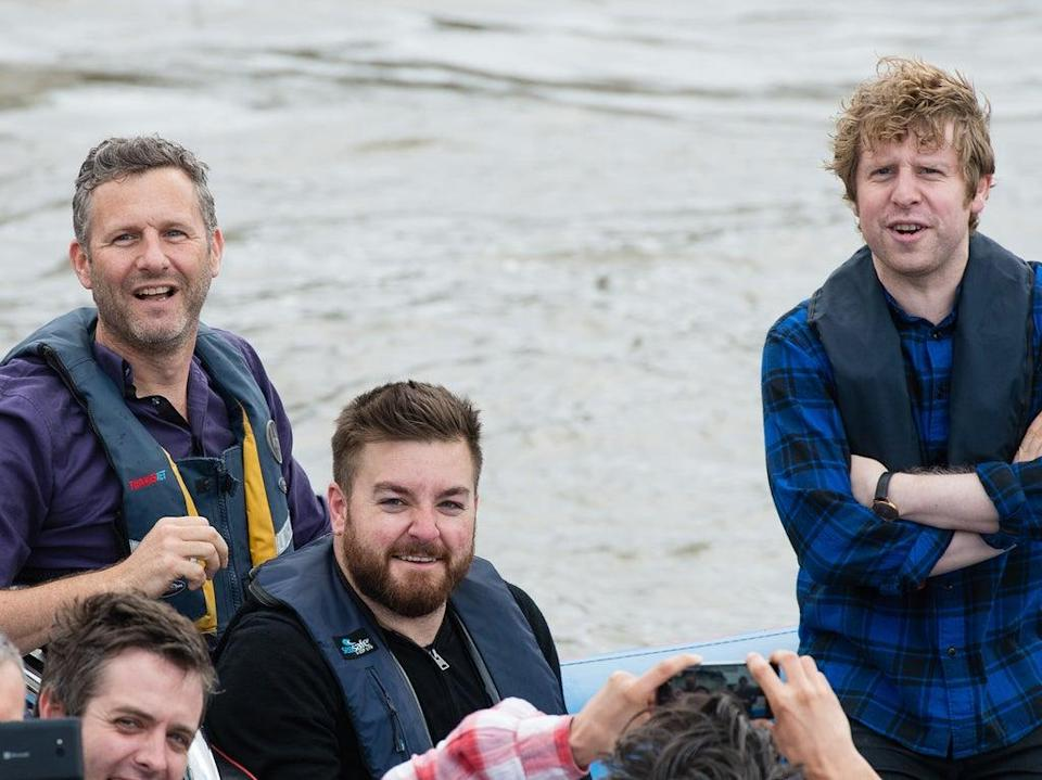 Brooker (centre) and 'Last Leg' co-hosts Adam Hills and Josh Widdicombe pursuing Nigel Farage for an interview in a boat on the River Thames in June 2016 (Getty Images)