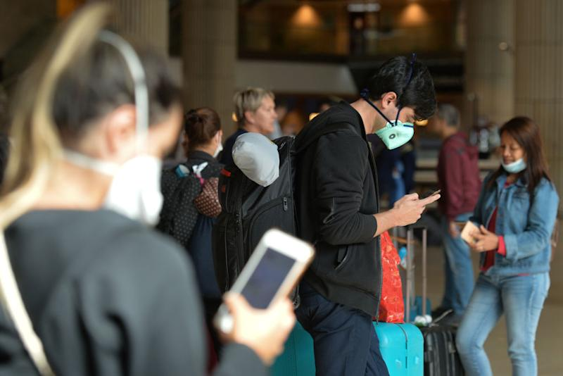 Passengers wearing protective masks seen in the arrivals hall of Terminal 3 at the Ben Gurion Airport, Tel Aviv-Yafo, Israel, on Tuesday, March 10, 2020. (Photo by Artur Widak/NurPhoto)
