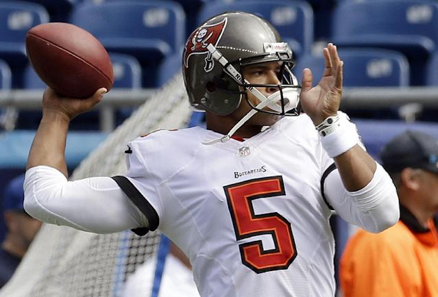 Tampa Bay Buccaneers quarterback Josh Freeman warms up before an NFL football game against the New England Patriots Sunday, Sept. 22, 2013, in Foxborough, Mass. (AP Photo/Stephan Savoia)