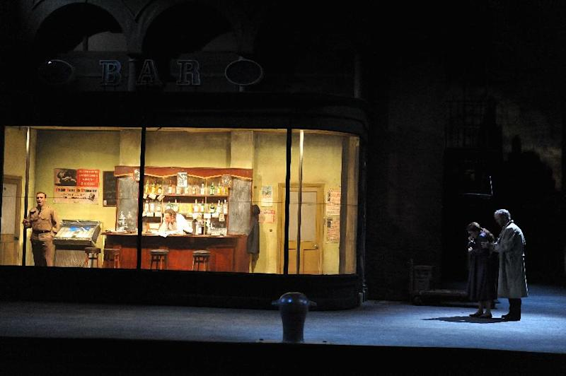 "This undated image released by the English National Opera shows a scene from a production of ""Rigoletto."" The British director Jonathan Miller famously reinvented ""Rigoletto"" for his 1982 staging at the English National Opera, moving it to Little Italy in the 1950s. Inspired by ""The Godfather"" movies and the film ""Some Like It Hot,"" Miller turned the Duke into a mafia boss and Rigoletto into a waiter at a mob hangout. (AP Photo/English National Opera, Chris Christodoulou)"