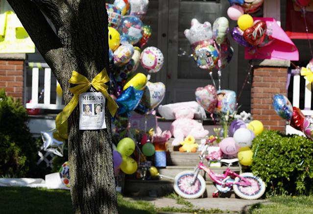 CLEVELAND, OH - MAY 09: Balloons and presents sit outside the home of kidnap victim Amanda Berry on May 9, 2013 in Cleveland, Ohio. Ariel Castro was arraigned on rape and kidnapping charges for abducting Berry, Gina DeJesus and Michelle Knight and holding them for about 10 years. No charges were filed against Ariel's brothers, Onil or Pedro and they were released by the judge. Bail was set at $8 million for Ariel. (Photo by Matt Sullivan/Getty Images)