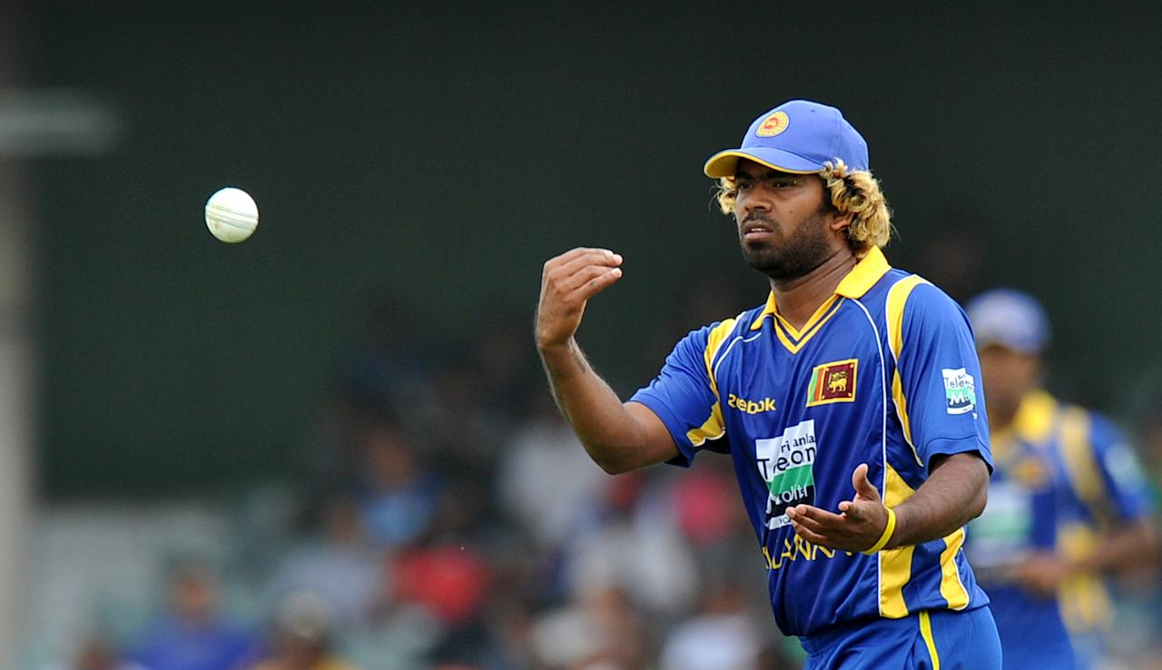 Sri Lankan cricketer Lasith Malinga throws a ball during the 2nd One Day International match between South Africa and Sri Lanka at the Buffalo Park in East London on January 14, 2012.   AFP PHOTO/ ALEXANDER JOE (Photo credit should read ALEXANDER JOE/AFP/Getty Images)