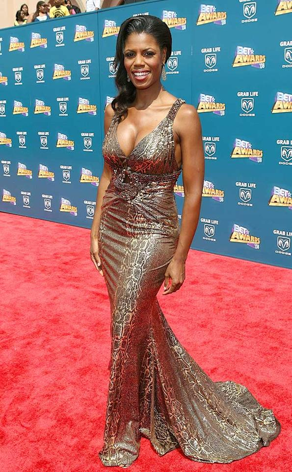 "Reality TV vixen Omarosa Manigault-Stallworth impressed in a metallic floor-length evening gown. Maury Phillips/<a href=""http://www.wireimage.com"" target=""new"">WireImage.com</a> - June 24, 2008"