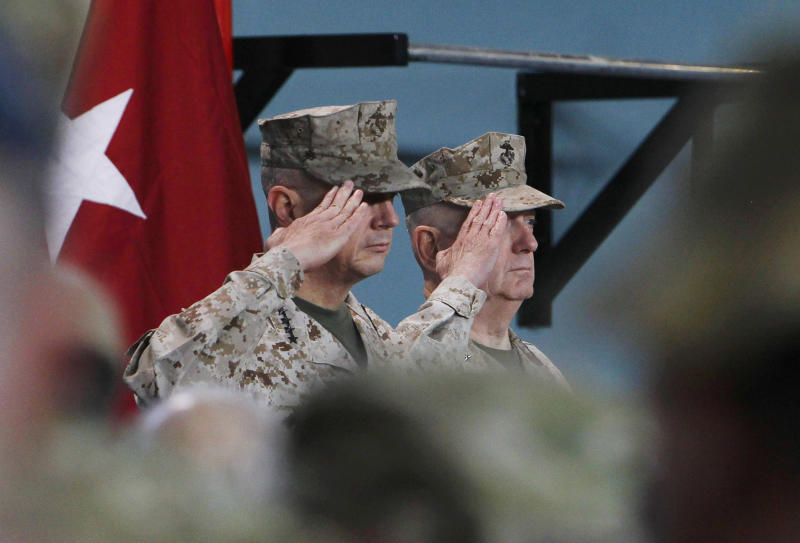 U.S. Gen. John Allen, left, the outgoing U.S. and NATO- led International Security Assistance Force (ISAF) commander in Afghanistan salutes with upcoming U.S. and NATO-led International Security Assistance Force commander in Afghanistan U.S. Gen. Joseph Dunford during a changing of command ceremony in Kabul, Afghanistan, Sunday, Feb. 10, 2013. A new U.S. commander is at the helm of international forces in Afghanistan as Marine Gen. Joseph Dunford takes charge at a critical time for President Barack Obama and the military as foreign combat forces prepare to withdraw by the end of 2014. (AP Photo/Omar Sobhani, Reuters, Pool)