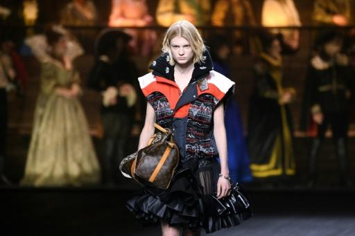A model presents a creation by Louis Vuitton during the Women's Fall-Winter 2020-2021 Ready-to-Wear collection fashion show in Paris, touted as a 'lively and sparky stylistic clash' between past and present