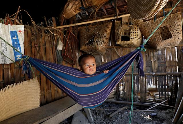 Tina Chakma, a six-month-old baby girl plays in an improvised hammock inside her parents' house on the outskirts of Agartala, India, March 20, 2018. REUTERS/Jayanta Dey TPX IMAGES OF THE DAY