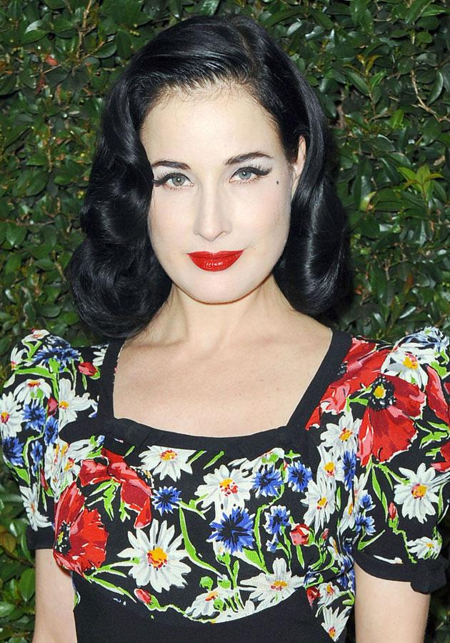 """Celebrities wearing red lipstick: Dita Von Teese smouldered at the <a href=""""http://uk.lifestyle.yahoo.com/photos/vogue-and-mac-cosmetics-party-best-dressed-list-slideshow/"""" data-ylk=""""slk:Vogue / MAC party;outcm:mb_qualified_link;_E:mb_qualified_link;ct:story;"""" class=""""link rapid-noclick-resp yahoo-link"""">Vogue / MAC party</a>.<br><br>[Rex]"""