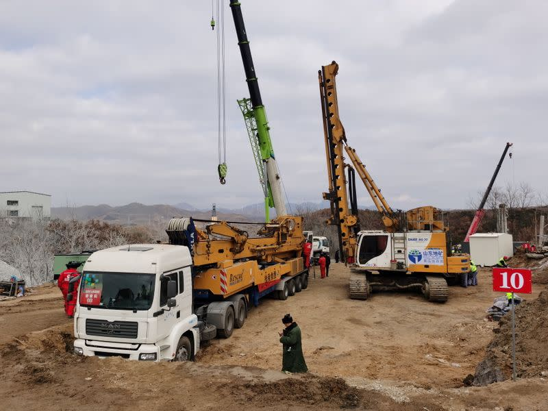 Rescuers are seen at the site where workers were trapped underground after an explosion at the gold mine under construction, in Qixia