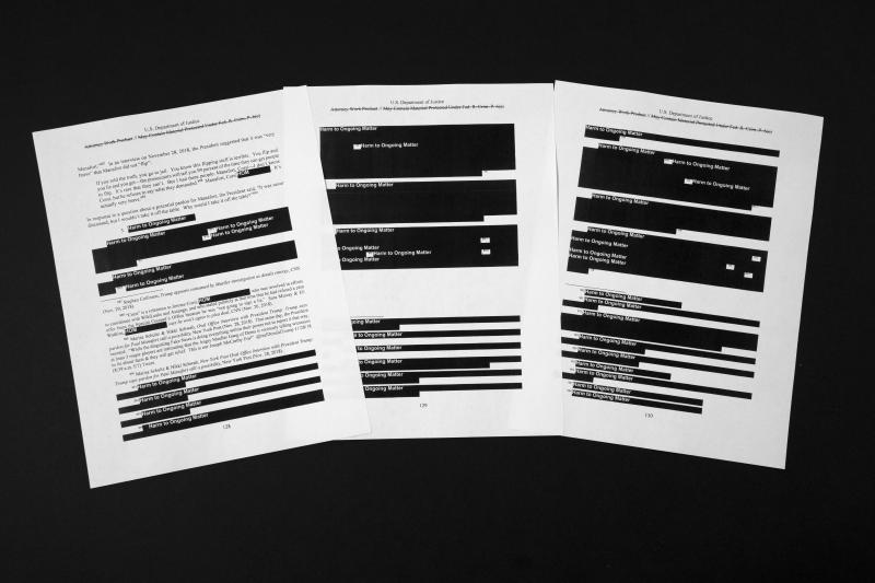 Special counsel Robert Mueller's redacted report on the investigation into Russian interference in the 2016 presidential election is photographed Thursday, April 18, 2019, in Washington. The pages refer to former campaign chairman Paul Manafort. (AP Photo/Jon Elswick)