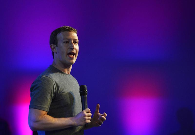 US chairman and chief executive of Facebook Mark Zuckerberg gestures as he presents in New Delhi on October 9, 2014