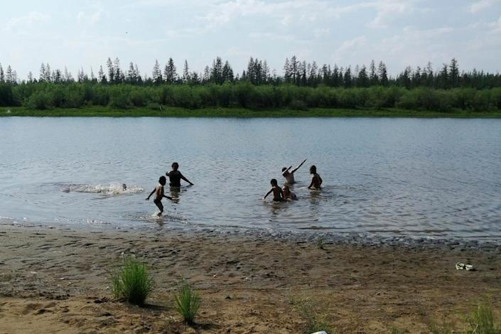 Children play in the Krugloe Lake outside Verkhoyansk, Sakha Republic, about 2,900 miles northeast of Moscow. Russia's meteorological service said the thermometer hit 100.4 degrees June 20 in Verkhoyansk.