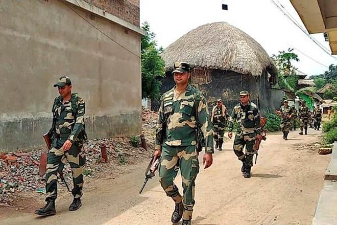 Central force personnel conduct a march at a village in Birbhum following reports of clash between BJP and TMC on Saturday (PTI Photo)