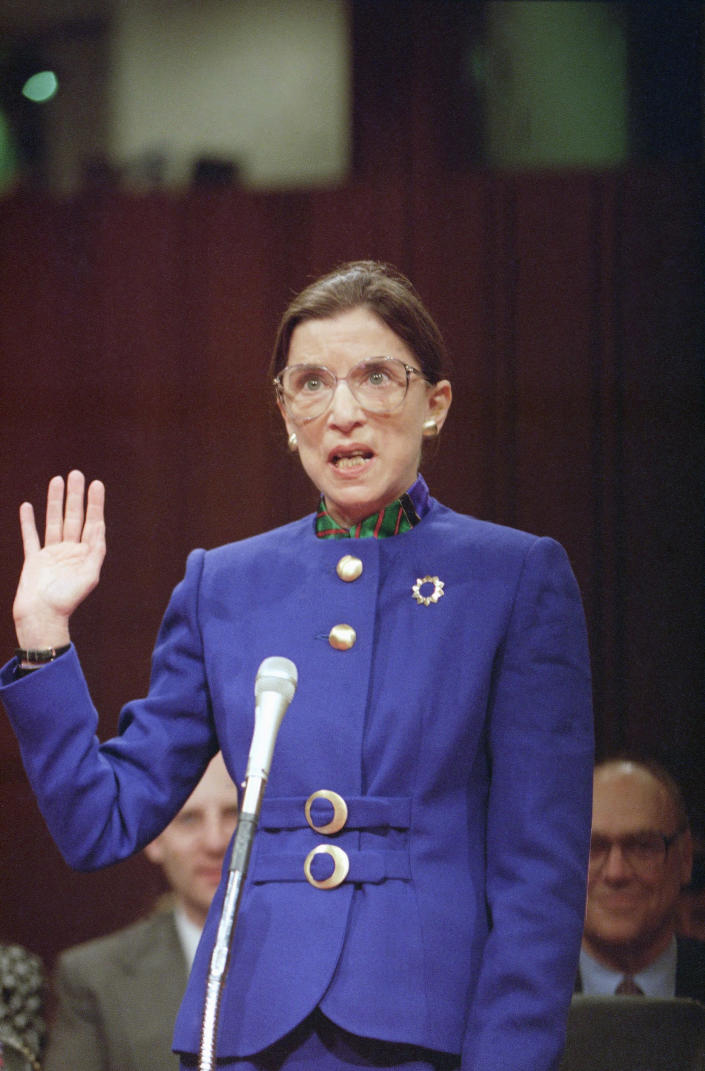 "Supreme Court nominee Judge Ruth Bader Ginsburg is sworn in to her confirmation hearing of the Senate Judiciary Committee on Capitol Hill. Ginsburg told the committee that while she rose ""on the shoulders"" of women's rights pioneers, advocacy is not her vision of a justice's role. (Photo: Doug Mills/AP)"