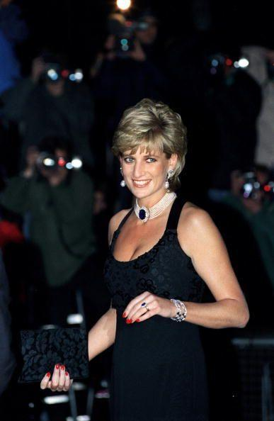 <p>Princess Diana received a giant sapphire brooch as a gift from the Queen Mother and fashioned it into a multi-strand pearl choker, which she wore on several occasions throughout the '90s—here, she attends a London gala in 1995.</p>