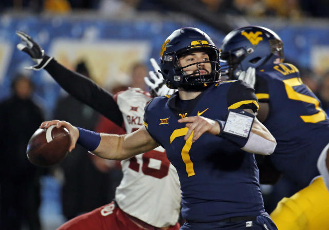 West Virginia QB Will Grier is one of several high-profile players skipping bowl games in preparation for the 2019 NFL Draft. (Getty)