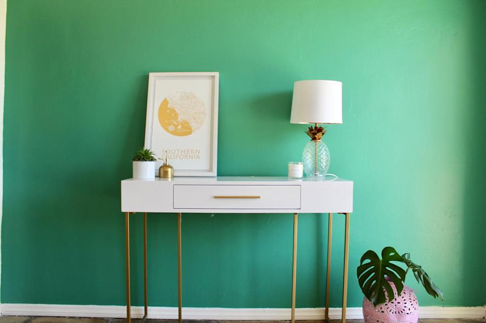 """<p>Green can be calming and it can also be energizing—something you need when deadlines approach. """"A bright, jazzy green, like <a href=""""https://www.sherwin-williams.com/homeowners/color/find-and-explore-colors/paint-colors-by-family/SW0060-alexandrite#/0060/?s=coordinatingColors&p=PS0"""" rel=""""nofollow noopener"""" target=""""_blank"""" data-ylk=""""slk:Alexandrite SW 0060"""" class=""""link rapid-noclick-resp"""">Alexandrite SW 0060</a>, brings a touch of playfulness to a home office,"""" says Sue Wadden, director of color marketing at <a href=""""https://www.sherwin-williams.com/sherwinwilliams"""" rel=""""nofollow noopener"""" target=""""_blank"""" data-ylk=""""slk:Sherwin-Williams"""" class=""""link rapid-noclick-resp"""">Sherwin-Williams</a>. """"Keep accents neutral, such as gold and silver, or white décor so the room stays uncluttered.""""</p>"""