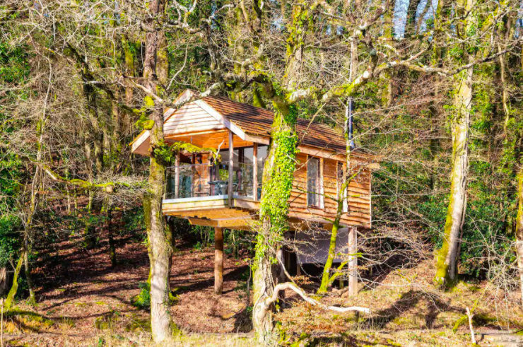 """<p>Live out your fairy tale dreams at Yeworthy Eco Treehouse in Eworthy, Devon. Nestled in a secluded setting amongst the tree-tops, it's perfect for anyone looking to escape everyday life. </p><p>Some standout features to look out for include the log-burning fireplace, rowing boat (the lake is situated opposite) and idyllic views. A composting sawdust toilet house is located separately, but don't let that put you off. It's the ultimate planet-friendly stay. </p><p><a class=""""link rapid-noclick-resp"""" href=""""https://airbnb.pvxt.net/e4KVdg"""" rel=""""nofollow noopener"""" target=""""_blank"""" data-ylk=""""slk:BOOK NOW"""">BOOK NOW </a></p>"""