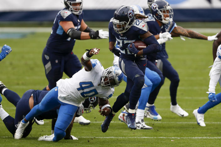 Tennessee Titans running back Derrick Henry (22) breaks away from Detroit Lions middle linebacker Jarrad Davis during the first half of an NFL football game Sunday, Dec. 20, 2020, in Nashville, N.C. (AP Photo/Wade Payne)