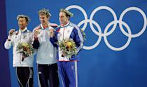 <b>Medal No. 4</b><br>Takashi Yamaoto of Japan (far left), Michael Phelps of USA and Stephen Parry of Great Britain pose with their medals for the men's swimming 200m butterfly event on August 17, 2004 during the Athens 2004 Summer Olympic Games at the Main Pool of the Olympic Sports Complex Aquatic Centre in Athens, Greece.