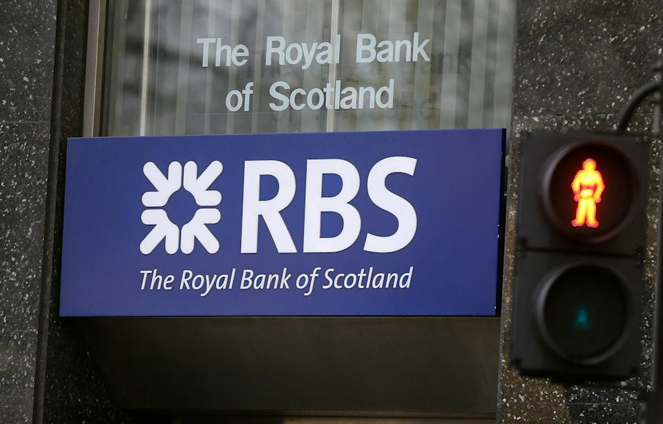FILE - This is a Friday, Feb. 26, 2016 file photo of a logo of a branch of the Royal Bank of Scotland in London. Royal Bank of Scotland swung to a loss in the second quarter of 2016 as it set aside more cash to cover litigation and conduct issues as it cleans up the problems that led to a taxpayer-funded bailout at the height of the global financial crisis. The now government-controlled bank on Friday Aug. 5, 2016 reported a pretax operating loss of 695 million pounds ($913 million) compared with a profit of 224 million pounds in the same quarter a year earlier (AP Photo/Frank Augstein, File)