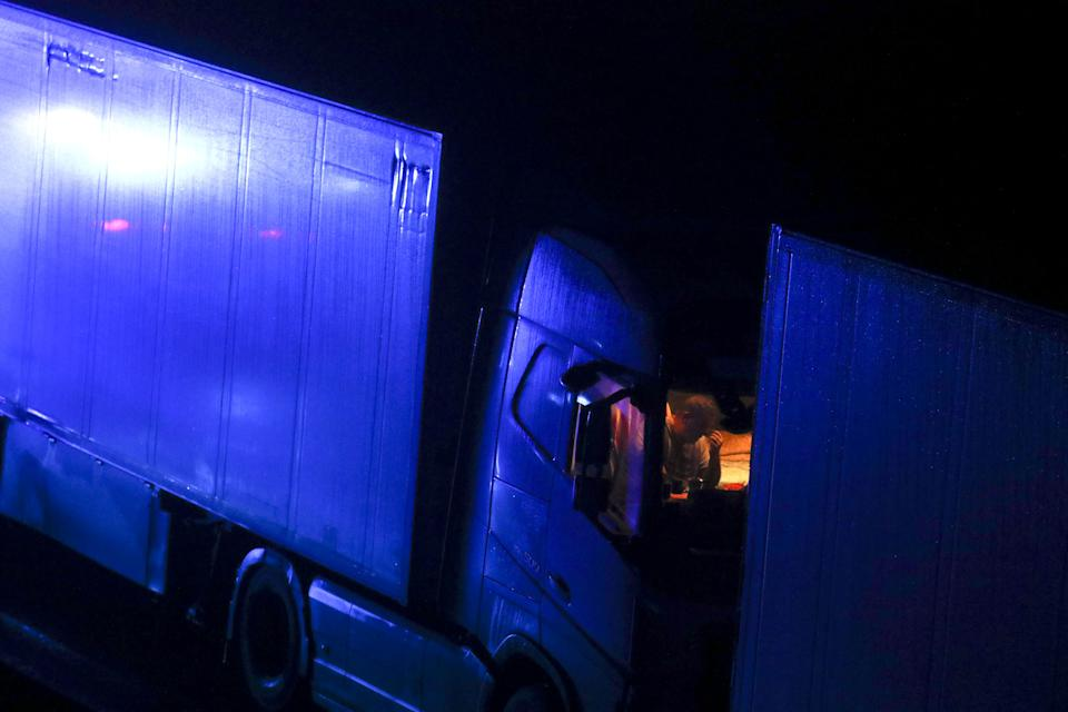 A drive sits in the cab of his lorry while parked on the M20 in Kent after the Port of Dover was closed after the French government's announcement it will not accept any passengers arriving from the UK. France appears set to end a ban on hauliers crossing the Channel which was imposed due to fears about the spread of the new coronavirus strain. (Photo by Steve Parsons/PA Images via Getty Images)