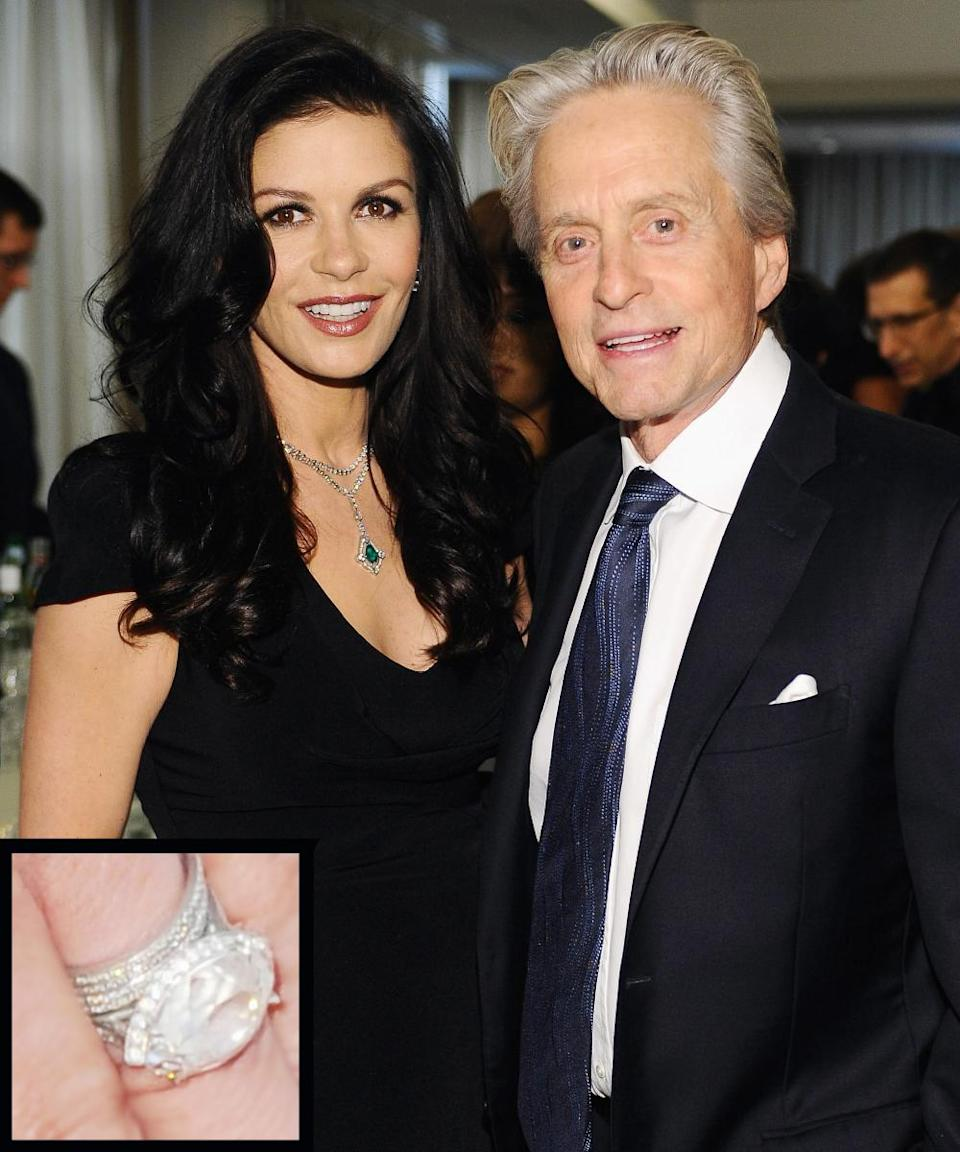<p>Michael Douglas proposed to Catherine Zeta-Jones in 1999 with a 10-carat side-set marquise diamond ring by Fred Leighton. The couple married in 2000.</p>
