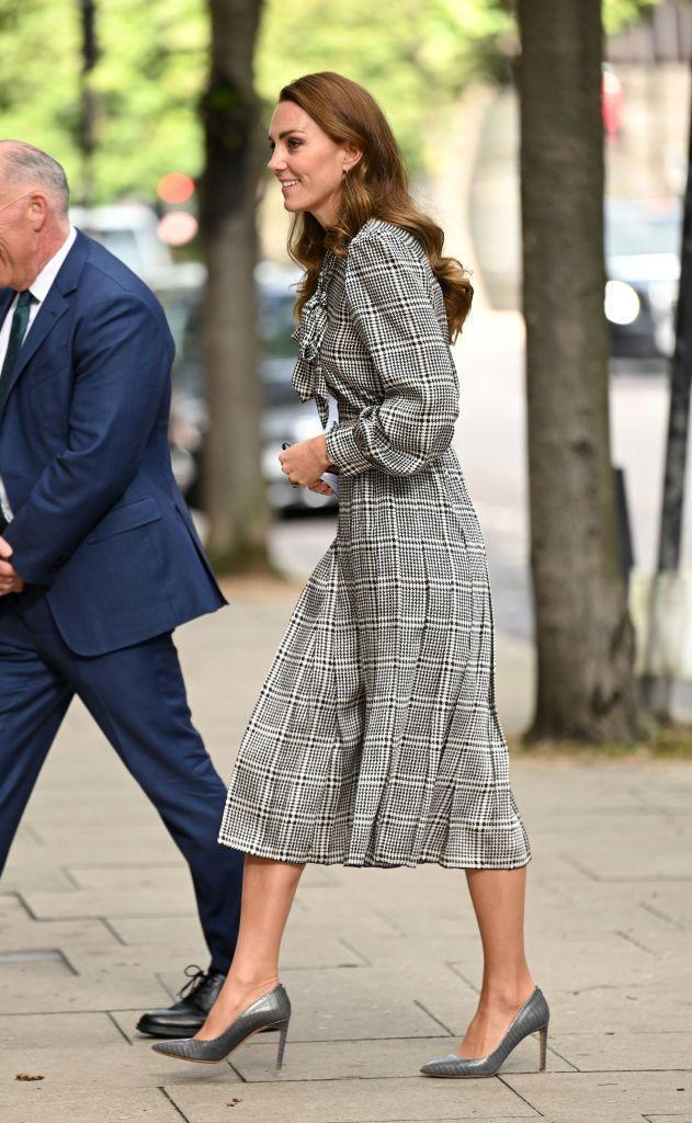 """<p>Kate re-wore a <a href=""""https://www.townandcountrymag.com/society/tradition/a37864400/kate-middleton-black-white-dress-early-years-photos/"""" rel=""""nofollow noopener"""" target=""""_blank"""" data-ylk=""""slk:black and white plaid Zara dress"""" class=""""link rapid-noclick-resp"""">black and white plaid Zara dress</a> to meet with researchers at University College of London. She paired the midi dress with grey pointed toe pumps and wore her hair in her signature loose waves. </p>"""