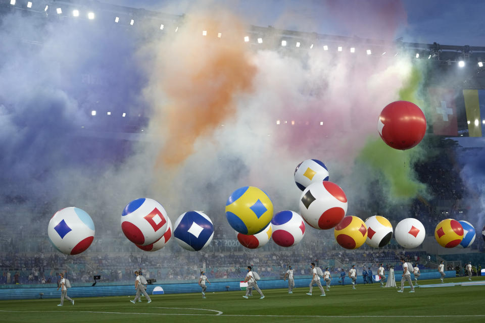 Artists perform prior to the Euro 2020, soccer championship group A match between Italy and Turkey, at the Rome Olympic stadium, Friday, June 11, 2021. (AP Photo/Alessandra Tarantino, Pool)