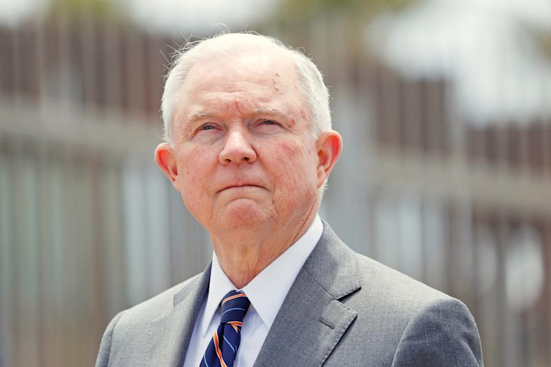 FILE PHOTO:    U.S. Attorney General Jeff Sessions looks on during a news conference next to the U.S. Mexico border wall to discuss immigration enforcement actions of the Trump Administration near San Diego, California, U.S. May 7, 2018.   REUTERS/Mike Blake/File Photo
