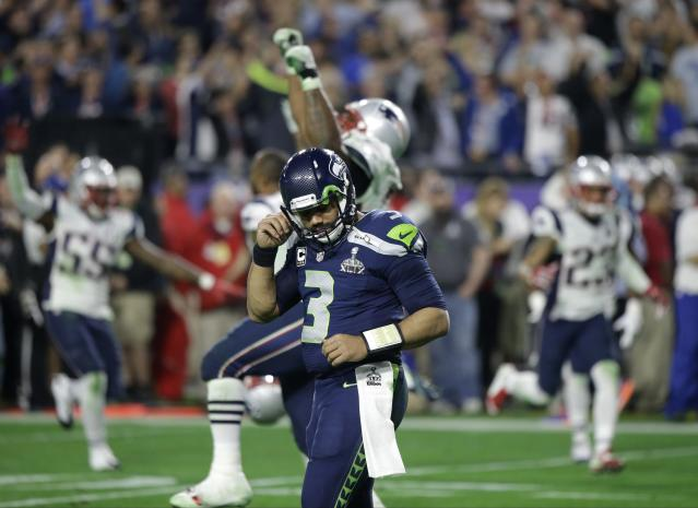 "<a class=""link rapid-noclick-resp"" href=""/nfl/players/25785/"" data-ylk=""slk:Russell Wilson"">Russell Wilson</a> reacts after throwing an interception at the goal line that would have won Super Bowl XLIX. (AP)"