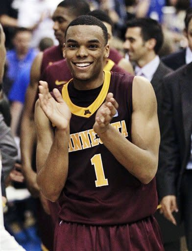 Minnesota guard Andre Hollins leaves the court after defeating Middle Tennessee 78-72 in a quarterfinal NIT college basketball tournament game on Wednesday, March 21, 2012, in Murfreesboro, Tenn. (AP Photo/Mark Humphrey)