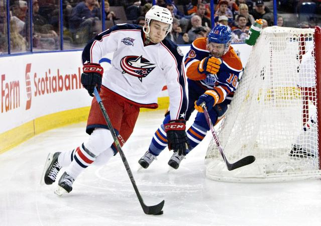 Columbus Blue Jackets' Alexander Wennberg (41) is chased by Edmonton Oilers' Teddy Purcell (16) during second period NHL hockey action in Edmonton, Canada on Wednesday March 18, 2015. (AP Photo/The Canadian Press, Jason Franson)