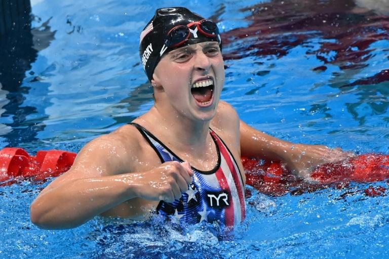 US swimmer Katie Ledecky celebrates after winning the final of the women's 1500m freestyle at the Tokyo Olympics
