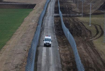 A Hungarian police van patrols the Hungary-Serbia border, which was recently fortified by a second fence, near the village of Gara, Hungary March 2, 2017. REUTERS/Laszlo Balogh