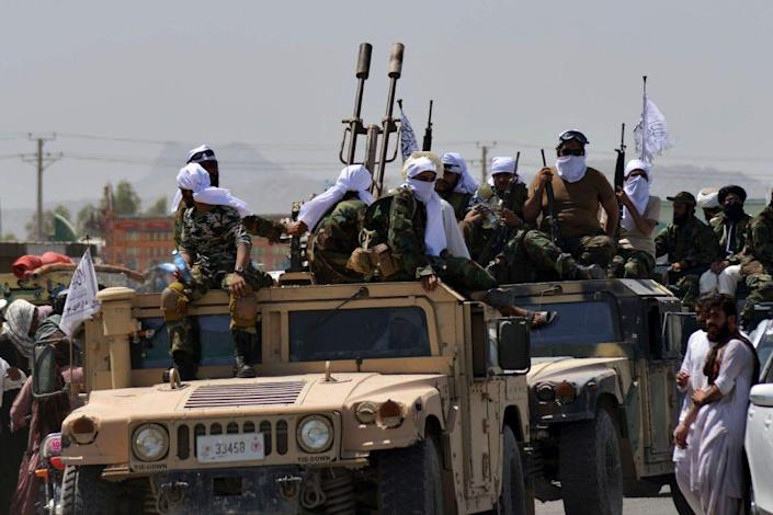 Taliban fighters atop Humvee vehicles parade along a road to celebrate after the US pulled all its troops out of Afghanistan, in Kandahar on September 1, 2021 following the Talibans military takeover of the country.
