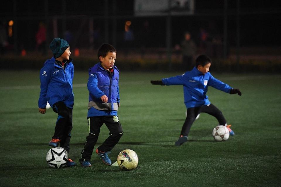 China's football association is hoping to instil a love of the 'beautiful game' in children across the country (AFP Photo/Greg Baker)