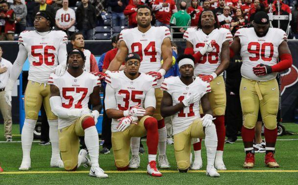 PHOTO: San Francisco 49ers' Eli Harold (57), Eric Reid (35) and Marquise Goodwin (11) kneel during the national anthem before an NFL football game against the Houston Texans, in Houston, Dec. 10, 2017. (David J. Phillip/AP, FILE)