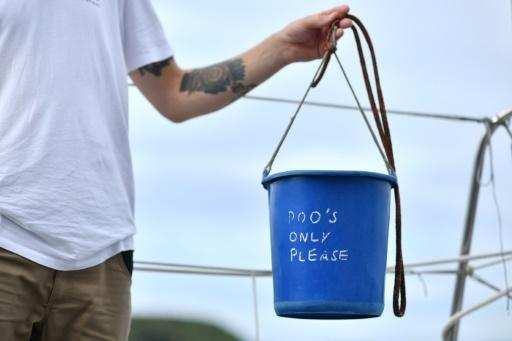 The toilet is a blue plastic bucket, complete with a biodegradable bag that can be thrown overboard