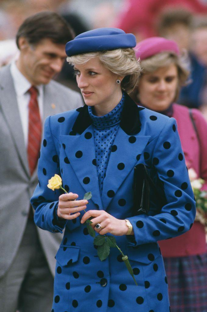 """<p>Diana's love of <a href=""""https://www.townandcountrymag.com/style/fashion-trends/g28367509/princess-diana-polka-dots-style/"""" rel=""""nofollow noopener"""" target=""""_blank"""" data-ylk=""""slk:polka dots"""" class=""""link rapid-noclick-resp"""">polka dots</a> continued in the years to come. For a royal visit in British Columbia in May 1986, Diana went for a bold combination: she wore a patterned blouse <em>and </em>blazer. </p>"""