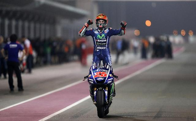 Movistar Yamaha MotoGP's Spanish rider Maverick Vinales celebrates after winning the 2017 Qatar MotoGP (AFP Photo/Karim JAAFAR)