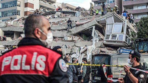PHOTO: Rescuers search for survivors at a collapsed building after a powerful earthquake struck Turkey's western coast and parts of Greece, in Izmir, on Oct. 30, 2020. (Mert Cakir/AFP via Getty Images)
