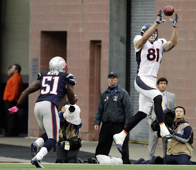 Denver Broncos tight end Joel Dreessen (81) catches a touchdown pass in front of New England Patriots linebacker Jerod Mayo (51) in the second quarter of an NFL football game, Sunday, Oct. 7, 2012, in Foxborough, Mass. (AP Photo/Stephan Savoia