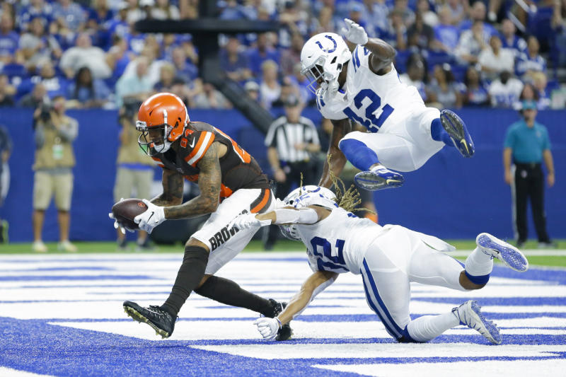 Cleveland Browns wide receiver Derrick Willies (84) makes a catch for a touchdown in front of Indianapolis Colts cornerback Jalen Collins (32) and defensive back Rolan Milligan (42) during the second half of an NFL preseason football game in Indianapolis, Saturday, Aug. 17, 2019. (AP Photo/AJ Mast)