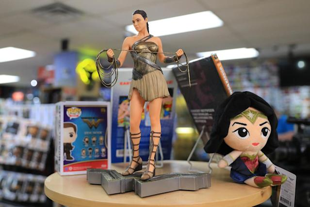 <p>A statue and stuffed figure of Wonder Woman on display at Midtown Comics in New York City. (Gordon Donovan/Yahoo News) </p>