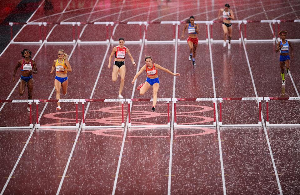 <p>TOKYO, JAPAN - AUGUST 02: Femke Bol of Team Netherlands clears the final hurdle as rain falls in the Women's 400 metres hurdles semi finals on day ten of the Tokyo 2020 Olympic Games at Olympic Stadium on August 02, 2021 in Tokyo, Japan. (Photo by Matthias Hangst/Getty Images)</p>