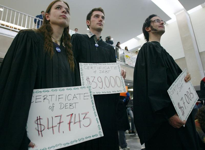 Students holding their 'Certificates of Debt' at graduation. (Bernard Weil/Toronto Star via Getty Images)
