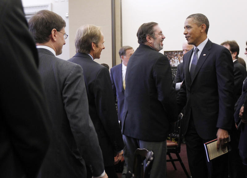 "FILE - In this Jan. 11, 2012, file photo President Barack Obama talks with United Steelworkers (USW) President Leo W. Gerard, center, during a roundtable meeting about Insourcing American Jobs in the Eisenhower Executive Office Building on the White House campus in Washington. AFL-CIO leaders hope to smooth tensions at their executive council's annual winter meeting that starts Monday, March 12, 2012, with union leaders trying to repair bitter divisions over Obama's rejection of an oil pipeline from Canada to Texas. ""We need to get out the message that we're all in this together,"" said Gerard."" (AP Photo/Pablo Martinez Monsivais)"