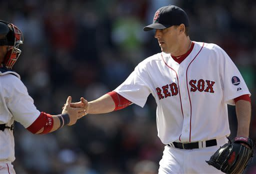 Boston Red Sox starting pitcher John Lackey, right, is congratulated by catcher Jarrod Saltalamacchia after the last out in the sixth inning of a baseball game against the Houston Astros at Fenway Park in Boston, Sunday, April 28, 2013. (AP Photo/Mary Schwalm)
