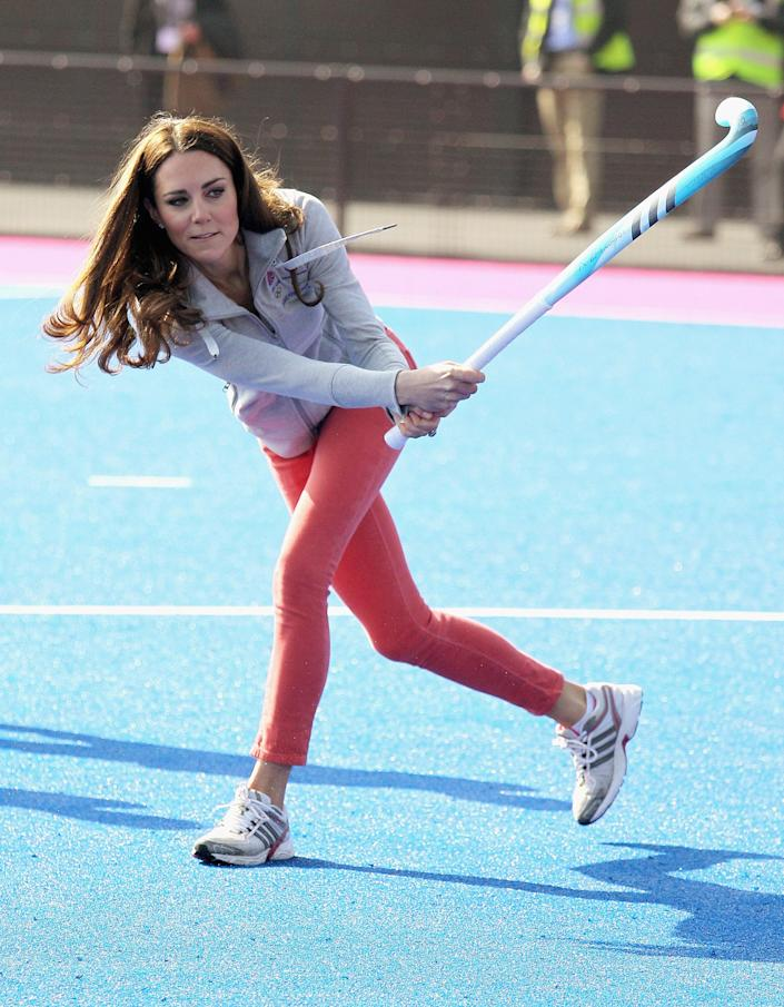 Britain's Duchess of Cambridge hits a shot as she plays hockey with the British Olympic hockey teams at the Riverside Arena in the Olympic Park, London, Thursday March 15, 2012. The Duchess of Cambridge viewed the Olympic Park and met members of the men's and women's British hockey teams. (AP Photo/Chris Jackson, Pool)