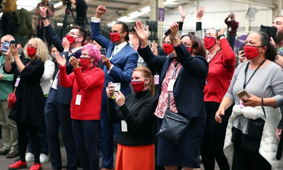 Labour supporters celebrate as Labour's Joanne Anderson is declared the mayor at Liverpool's Wavertree tennis centre.